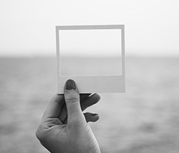 Hand holding an empty frame